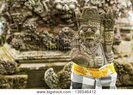 Traditional demon guards statue carved in stone in Indonesia.