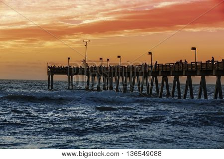 People on the pier waiting for sunset Florida