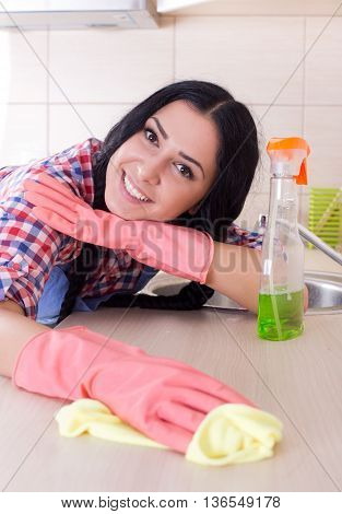 Cleaning Lady Wiping Countertop