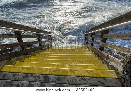 Wooden stairs to the beach flooded stormy sea Florida