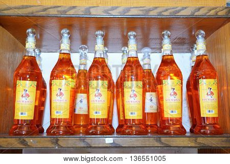 CORFU GREECE - MAY 17: The Koum Kouat liqueur degustation in local shop on May 17 2016 in Corfu Greece. It is a traditional alcohol beverage on Cofru island