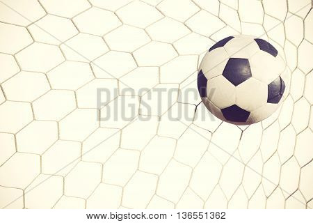 Soccer Ball In Goal On White Background Vintage Color
