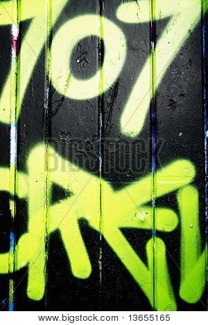green and black graffiti tag