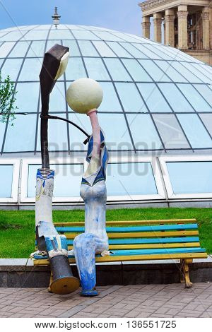 KIEV UKRAINE - MAY 16 2016: Artificial lanterns on the bench symbolizing a couple at Independence Square in Kiev Ukraine