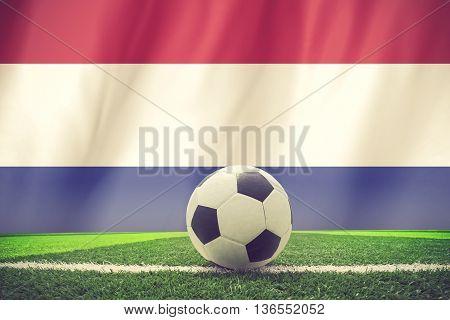 Netherlands soccer ball on grass vintage color
