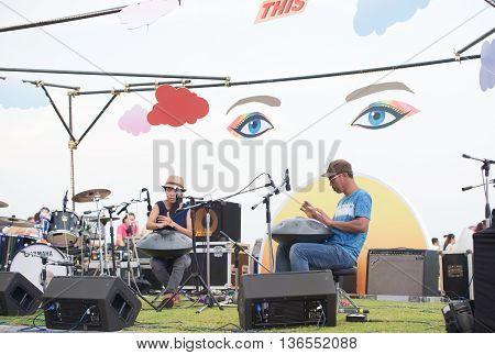 HUAHIN THAILAND-APR17: Honon band playing handpan was musical instrument from switzerland at seen space beach market huahinprachuapkirikan on 17 april 2016