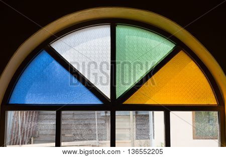 Old window with colorful glass , vintage