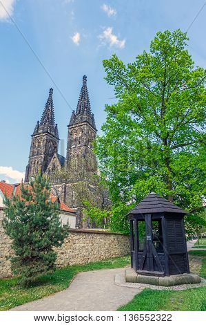 View on St. Peter & Paul Church from Vysehrad Park with the old well in the foreground, Prague, Czech Republic.