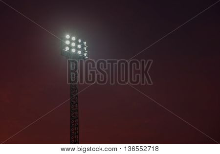 sportlights tower with background twilight in stadium