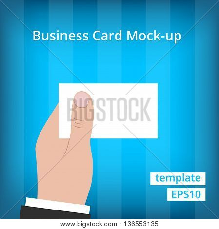 Business man in suit holding blank business card with one hand at blue background with stripes