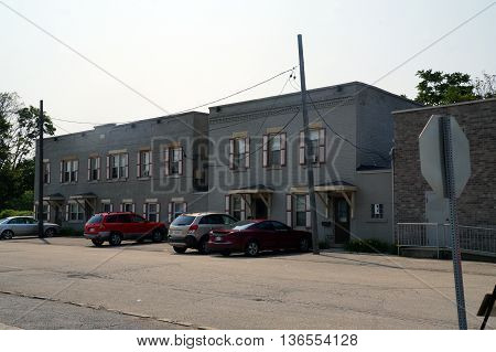 JOLIET, ILLINOIS / UNITED STATES - JUNE 30, 2015: People live in apartment buildings in downtown Joliet, Illinois.