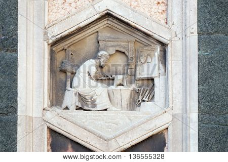 FLORENCE, ITALY - JUNE 05: Tubalcain by Nino Pisano, 1334-36, Relief on Giotto Campanile of Cattedrale di Santa Maria del Fiore(Cathedral of Saint Mary of the Flower), Florence, Italy on June 05, 2015