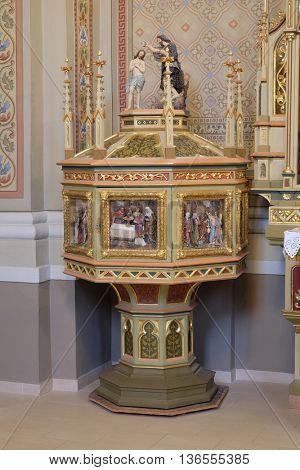 STITAR, CROATIA - AUGUST 27: Baptismal font in the church of Saint Matthew in Stitar, Croatia on August 27, 2015