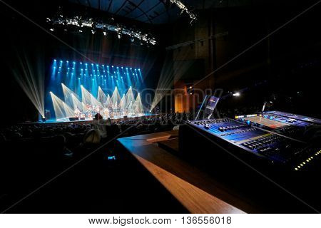 Auditorium with spectarors, stage with band and soundboard.