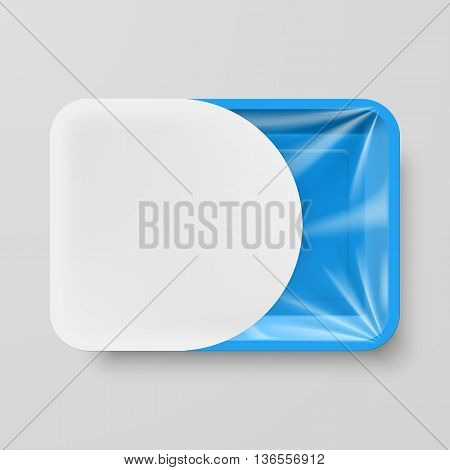 Empty Blue Plastic Food Container with White Label on Gray