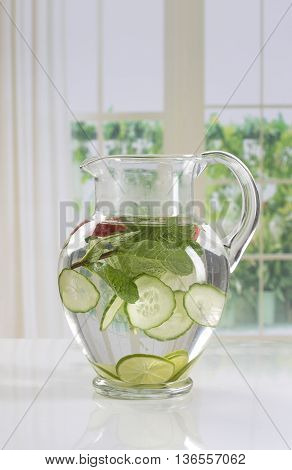 Detox water with cucumber and strawberry and lime