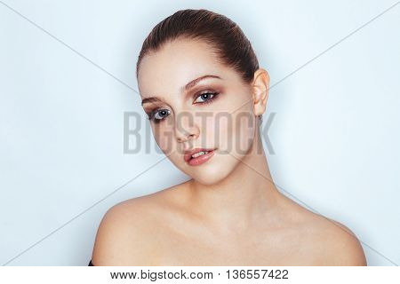 Glamour Close Up Portrait Of Young Beautiful Woman Model With Bare Shoulders Trendy Makeup. Fashion