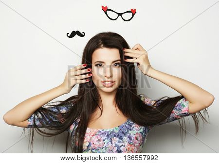 Party image.Young woman holding a party glasses.