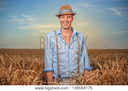 man standing in front of corn field