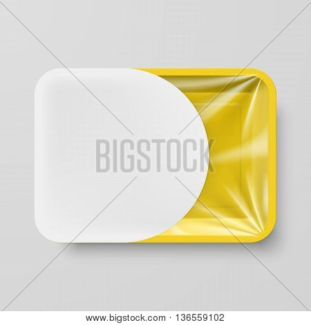 Empty Yellow Plastic Food Container with White Label on Gray