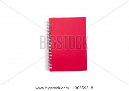 Red notebook spiral bound isolated on white background, close up red notebook