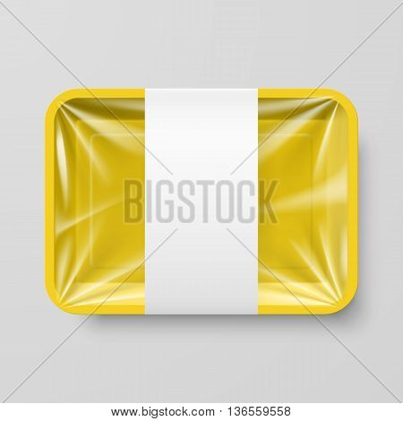Empty Yellow Plastic Food Container with Label on Gray Background