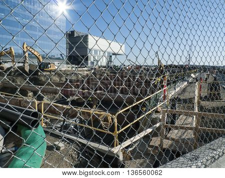 Boston Massachusetts USA - June 30 2016: Temporary two-foot diameter pipes being installed to brace foundation walls during construction on Pier 4 project in South Boston