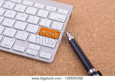 Business concept: computer keyboard with We're Hiring word on enter button background 3d render and copyspace area