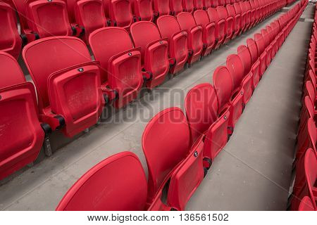 Rows of bright red seats at stadium