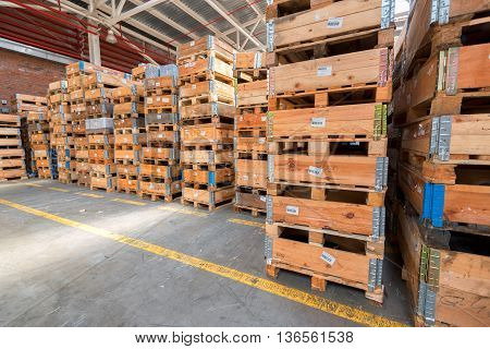 Large storehouse and many rows of wooden containers