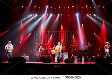 MOSCOW, RUSSIA - APR 24, 2015: Musicians of Secret band in concert during show on stage of Crocus city hall. Rock and roll band Secret founded in 1982 in Leningrad.