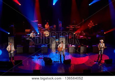 MOSCOW, RUSSIA - APR 24, 2015: Musicians of Secret band performs on stage in Crocus city hall. Secret band presents concert program On any side of Earth.