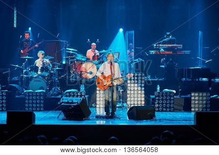 MOSCOW, RUSSIA - APR 24, 2015: A.Zabludovskii with guitar singing on stage in Crocus city hall during Secret band show. Secret band presents concert program On any side of Earth.