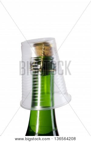 Champagne bottle with a plastic cup on a white background