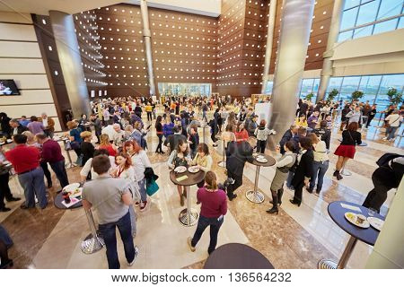 MOSCOW, RUSSIA - APR 24, 2015: People in cafeteria of Crocus city hall before show of group Secret. Crocus City Hall is a concert hall administratively located in Krasnogorsk Urban Settlement.