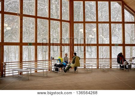 MOSCOW REGION, RUSSIA - DEC 28, 2014: People take rest in wooden house at Sports complex Stepanovo. Sports complex Stepanovo is located 50 km from Moscow.