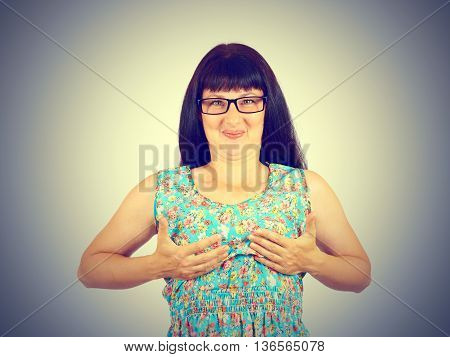 Funny Young Woman Holding Her Breasts In His Hands.