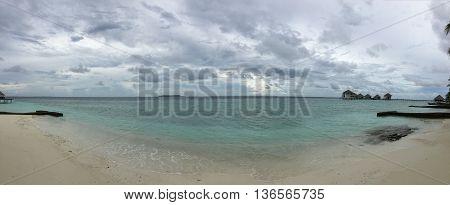 Maldive Beach Island resort landscape view of water bungalows