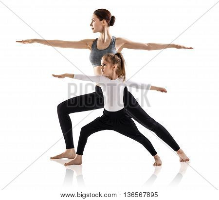 Mother and daughter doing yoga exercise isolated on white background