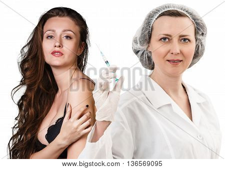 Female doctor with syringe with patient isolated on white
