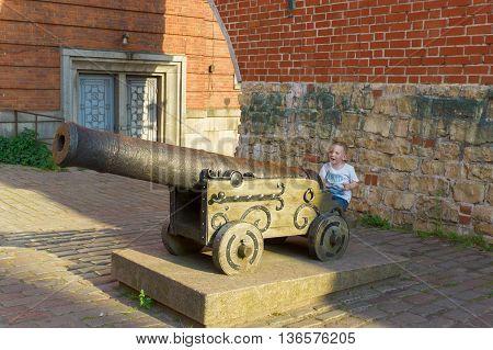Little Boy And Ancient Gun