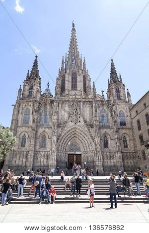 BARCELONA SPAIN -MAY 11 2016. Tourists on the square in front of Barcelona Cathedral. It is the Gothic cathedral constructed from the 13th to 15th centuries.
