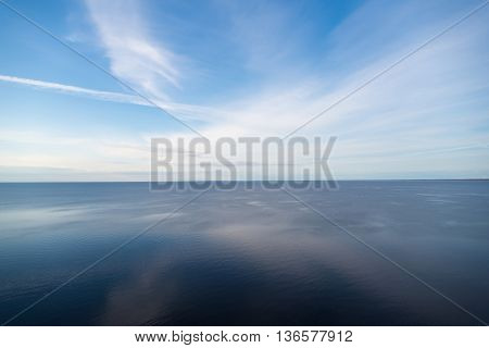 blue sky reflected in lake nature background
