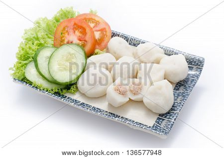 Fish ball with meat and sliced cucumber tomato hebs on plate