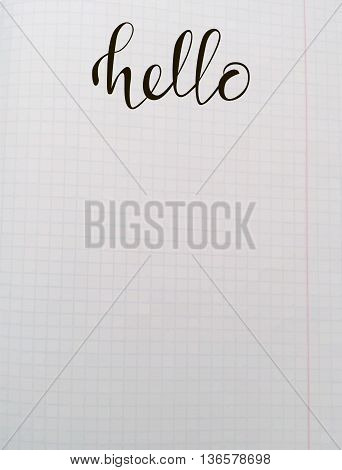 Hand drawn lettering - Hello. For cards print web. Vector illustration. White on school notebook background