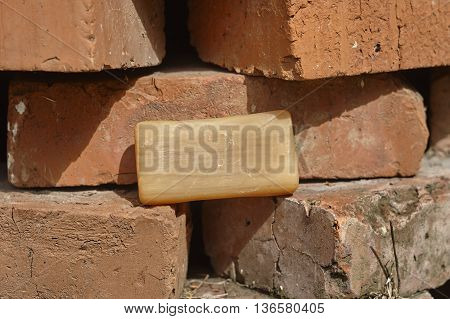 common soap household soap on brick wall close up