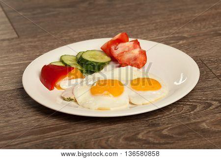 Breakfast set eggs and vegetable. Tomato, paprika.