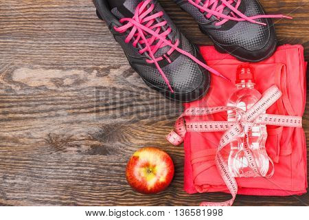 Sports Clothing With Apple And Bottle