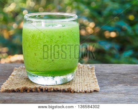 Green fruit smoothie, kiwi fruit smoothie on table