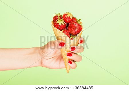 Waffle Cup With Strawberries In The Hand